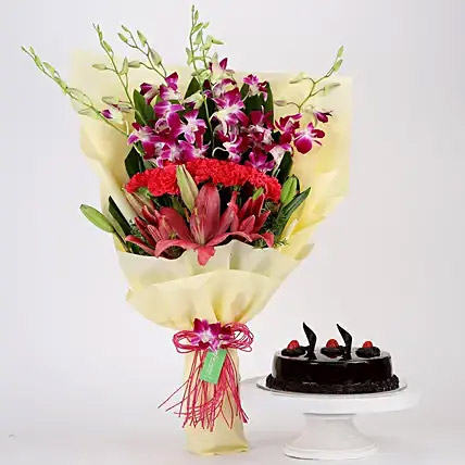 Pink and Purple Flowers and Truffle Cake Combo: Gifts To India