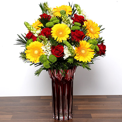 Bright Mixed Flowers In Red Vase: