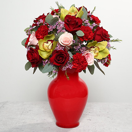 Mixed Flowers In Red Glass Vase: