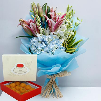 Pretty Flowers Bunch and Motichoor Laddoo Combo: Sweets