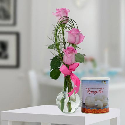 Pink Roses Arrangement and Rasgulla Combo: Flowers With Sweets