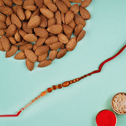 Elegant Red Rudraksha Rakhi And Almonds: Rudraksha Rakhi