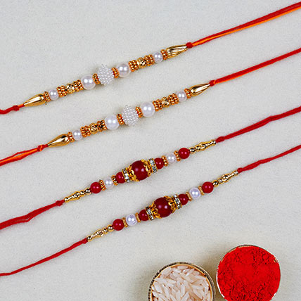 Set Of 4 Pearl Thread Rakhis: Set of 4 Rakhi