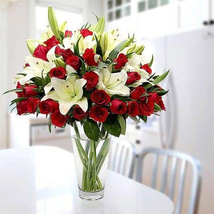 Cherish Joy With Lilies And Roses: